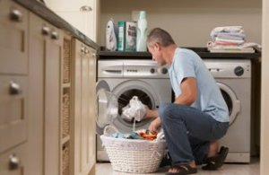 Man taking washing out of washing machine
