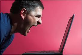 man screaming at computer