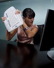 woman throwing keyboard