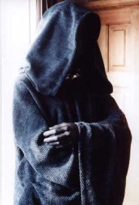 cloaked man