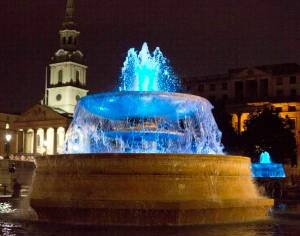 The fountains at Trafalgar Square are seen lit blue to signify the birth of a baby boy to Britain's Prince William and Catherine, Duchess of Cambridge in London