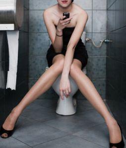 texting on toilet