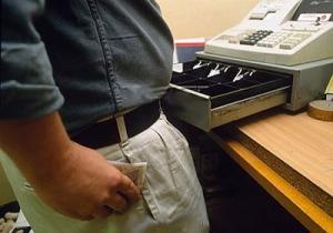 MAN STEALING MONEY FROM A CASH REGISTER - MODEL